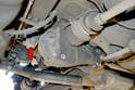 The mount attaches to the rear of the differential housing (red arrow) and can easily be inspected for any tears or degradation.