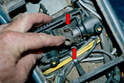 Use a flathead screwdriver and remove the two clips on the rod that goes through the coupler (red arrows).