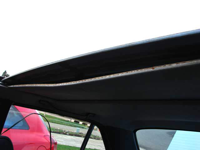 With sunroof halfway open unclip the leading edge of sunroof headliner.