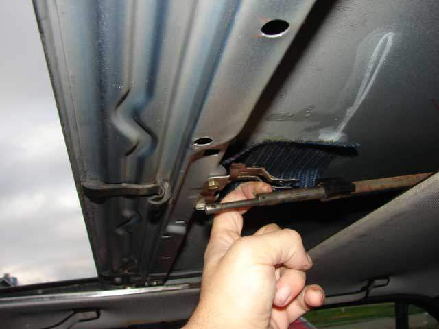 Using gentle pressure to hold the cable and tube down away from the sunroof and use the motor or emergency crank to advance the cable forward until it reaches the wind deflector.