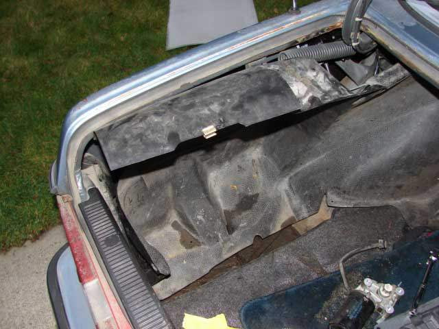 Remove the driver's side trunk liner.