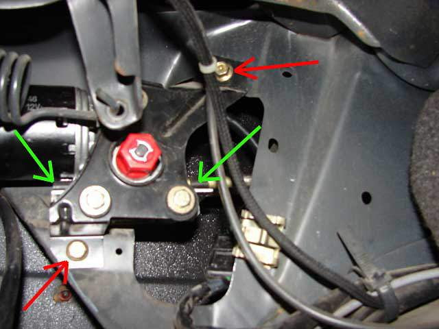 Unbolt the sunroof motor and bracket (red arrows) and unclip guide tubes from motor (green arrows).