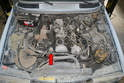 The EGR valve is located on the right side of the motor right by the thermostat housing (red arrow)