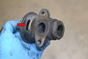 This photo illustrates the viewing port (red arrow) on the EGR valve with it out of the vehicle.