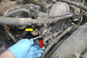 Use a 13mm (red arrow) and 12mm socket (yellow arrow) to remove the housing hardware.