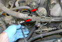 There are two 6mm Allen bolts holding the valve to the intake manifold, use a 6mm Allen and remove the two bolts (red arrows).