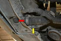 Working under the car remove the two lower hoses and be prepared for even more coolant to escape.
