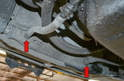 Next use a 19mm wrench and remove the two transmission cooling lines (red arrows).