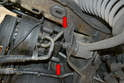 To remove the A/C belt loosen the two 17mm bolts on the rear of the compressor (red arrows) from below.