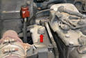 The sensor is located on the intake manifold between the turbo plumbing and the valve cover (red arrow).
