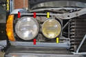 You can now access the Philips head screws that hold the headlight and fog light rings and lamps in place.