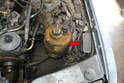 The relay is located in the left front corner of the engine bay and is attached to the inside of the fender (red arrow).