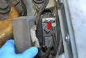 Before replacing the relay check the fuse (red arrow).