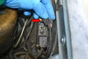 To replace the relay, pull the connection for the coolant sensor and dash light (red arrow) off the relay and check for any obvious damage or corrosion.