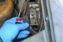 Next remove the connections for the glow plug wires and also check for damage or corrosion (red arrow).