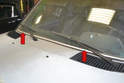 There are two windshield wipers on the front windshield; you are going to be lifting them off of the glass to change the blades and if you drop the metal arm back onto the windshield while doing this job you will probably break the glass, so use care and if you are worried put a piece of cardboard or a thick towel over the windshield while working.