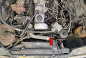 The vacuum pump (red arrow) is located on the left front of the engine.