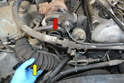 Remove the air intake (yellow arrow) from the turbo inlet (red arrow) by loosening the clamp and slipping it off.