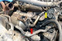 There is a pipe from the lower section of the trap (red arrow) that feeds the EGR valve (yellow arrow).