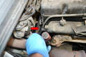 Move the tube out of the way and use a 12mm wrench to remove the turbo boost line from the rear of the manifold.