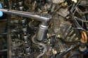 Disconnect the hoses from each injector and using an injector removal socket or a deep 27mm remove the injectors.