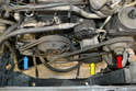 With the fan and shroud removed you can see the four drive or V-belts.
