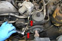 Use a 13mm socket and loosen the two bolts on the right side of the power steering pump (red arrows).