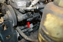 Use a 13mm socket and loosen the slider nut on the left side (red arrow).