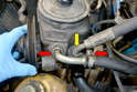 There is a supply and return line attached to the pump that you will need to remove.