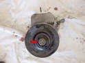 With the pump off you will need to remove the nut holding the pulley on.