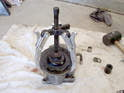 Use a three pronged puller and separate the pulley from the shaft.