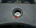 With the emblem removed you can see the 10mm Allen bolt that holds the wheel to the steering shaft (red arrow).