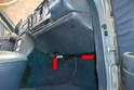 The passenger side is the same as the driver side; begin by removing the large plastic Philips head screws (red arrows).