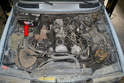 The battery for the W123 is located in the rear right corner of the engine bay.