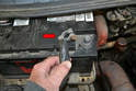 Next remove the positive strap from the positive post on the battery with a 13mm wrench (red arrow) and set it aside.