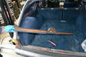 Lift the plastic trim piece up over the wiper assembly and remove it from the vehicle.