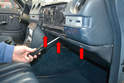 Next remove the trim pieces if you have them and using a Philips head screwdriver remove the three screws (red arrows) holding the panel to the dash.