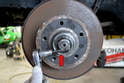Next use a 5mm Allen and loosen the pinch nut on the end of the spindle (red arrow).