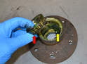 Remove the inner tapered bearing (red arrow).