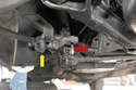 To replace the bushings on the idler arm you will first need to disconnect the drag link and tie rod ends (red arrow) from the link and disconnect the steering shock (yellow arrow) and move it out of the way.