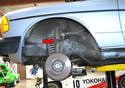 There is a single shock on each side (red arrow) along with a separate spring.