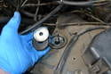 Remove the top washer and rubber isolator.