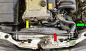 The radiator shroud is made up of two parts: the fan guard (yellow arrow) and the shroud (red arrow).