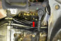 There is an engine block drain plug on the right side of the motor (red arrow) just behind the motor mount.