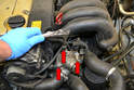 To flush out the engine block remove the three bolts (red arrows) on the thermostat housing.
