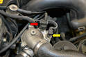 This photo illustrates the two sensors on the top of the thermostat housing; the red arrow indicates the sensor to the fuel injection management system while the yellow arrow indicates the sensor for the gauge cluster.