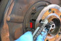 Rotate the hub so that you can remove the three 5mm Allen bolts holding the dust shield in place.