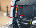 With the bulb bar removed use an 8mm socket and remove the four nuts holding the unit to the vehicle (red arrows).