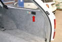Open the right side rear access panel by pulling back on the handle (red arrow) and then folding the panel down towards the seats.
