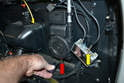 Remove the Philips head screw on the base of the unit (red arrow) as well as disconnect the antenna cable from the box (yellow arrow).